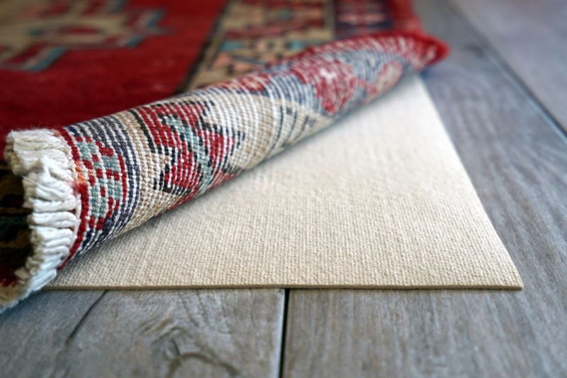 How should you protect your rugs